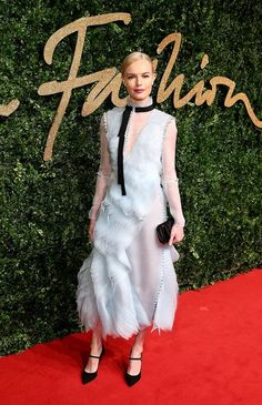 Kate Bosworth wears a light blue Erdem dress with ruffle detailing and Mary Jane heels