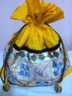 Bright Yellow drawstring hand embroidered silk batua bag by Dream Catchers Studio,  kolkata. Contact-8017191730
