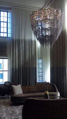 What an amazing space!  Notice the ombre in the drapery that is repeated in the chandelier.  This is what good interior design looks like.  Design by Gary Lee Partners.