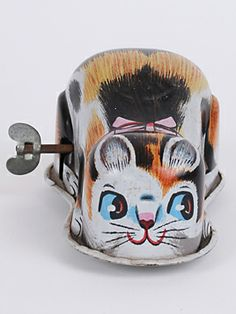 1960s Tin Toy Wind up Cat: Have hours of fun with this Japanese tin toy cat. Wind it up, see it scamper!