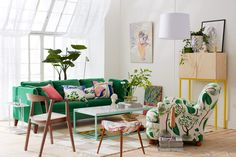 I like the green sofa with the colourful pillows.  Also check out that white arm chair with floral print. - Sköna hem