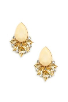 Pretty peach crystals are enough to dazzle any outfit. The earrings are approximately 1.5 inches in length.