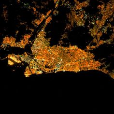Barcelona - captured from the ISS at night - is the largest metropolis on the Mediterranean Sea with approximately million residents. A happy orange and black Halloween from Daily Overview! Satellite View Of Earth, Earth At Night, Google Earth, Amazon Rainforest, Night City, Mediterranean Sea, Top View, Mother Earth, Cities
