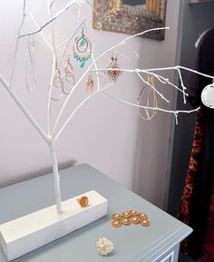 earring tree ~ take small branch, dry,  measure base, drill hole into block of wood, and spray paint.
