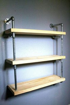 "Our originally designed industrial pipe wall shelf, featured in the RAW is an exciting addition to an already inspiring line of custom shelving. This unit is available AS SHOWN and is not customizable. It is sanded and ready for you to add your touches with stain, paint or even left unfinished. This unit is a beautiful way to showcase your books or other small items. The ""floating"" wall shelves used in this piece make very good use of space, so it is ideal for efficient living. The pieces…"