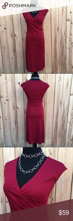 """🆕 """"Ruby"""" Red Bodycon Dress Form fitting (bodycon) dress by """"Ruby"""" is a gorgeous red. Flat lay measurements are 16"""" pit to pit, 14"""" waist & 41"""" long. Content is 100% Polyester. The material has a red sparkle to it. Can be seen in photo #7. Front top criss cross with rouching on the side. Tag stitching is coming out at neck. Otherwise in excellent condition with NO spots or damage. Ruby Dresses"""