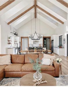Feeling wow'd on this Wednesday. 😯 - This is one grand living room and kitchen. Tons of natural light pours in to make it feel bright and lite. While the wood beams, casing, and furniture and warmth. What an open concept dream. New Living Room, Home And Living, Living Room Decor, Living Room With Sectional, Rustic Modern Living Room, Fixer Upper Living Room, Open Kitchen And Living Room, Boho Chic Living Room, Beautiful Living Rooms