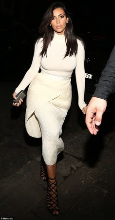 Kim Kardashian soaked up Sydney's hottest night spots in a form-fitting white ensemble with her favorite pair of black Hermes sandals http://dailym.ai/1AGnyJU