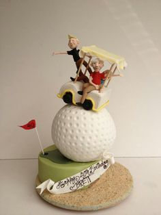 Golf cart balancing on a golf ball cake