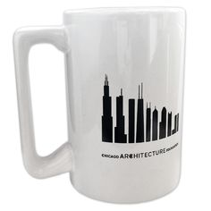 This large white mug, with a unique rectangular handle, features ten of Chicago's tallest buildings including Trump Tower, Willis Tower, Aon Center, and more. The other side of the mug has the name of