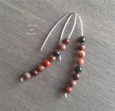 Light threaders in recycled sterling silver with sard beads by Harsh and Sweet.