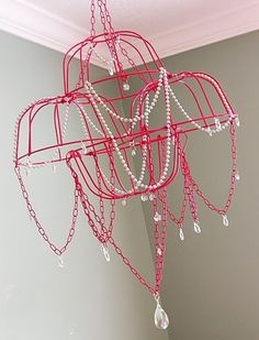 Glamorous, colorful, and modern, what is not to love about this chandelier created by Brassy Apple made with wire hanging baskets.
