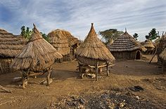Africa | Huts and supply shelters in a wanyatta. Village life. Indigenous people. Karamoja, Uganda | © Jorgen Schytte