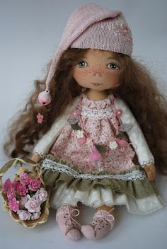 Flower Gnomochka, by Troy´s Toys.  She paints a beautiful and almost realistic child faces and sews dresses detail.