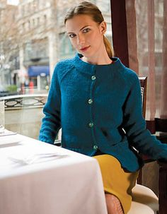 Lovely and ladylike, this raglan sleeved cardigan has sweet patch pockets and a stand-up collar. (Berroco)
