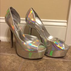 Steve Madden Holographic heels Steve Madden • Holographic Heels • platform shoes • open toed • size 7M •plenty of imperfections (pictured in second photo) • on the bottom/back of heels is writing in sharpie from the store I bought them from • of you want closer pictures of the imperfections just ask! - its hard to really see them due to the shoes being holographic unless you look for them • PRICE IS FIRM Steve Madden Shoes Heels