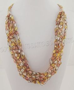 This is a pattern for an adjustable ladder ribbon necklace. Length may be adjusted from 18 inches to 30 inches. For this pattern, you would need 3 pony beads for adjusting the length. (See above Materials for crochet hook size).    To make necklace: (Make 3 or 4 strands using East Track II or Ladder Ribbon Maxi; 6 or 7 strands using Ladder Ribbon or Ladder Ribbon Glitter)