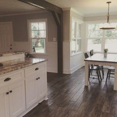Kitchen remodel. Farmhouse style. Shiplap. Cold Spring granite tops. Faux wood tile.