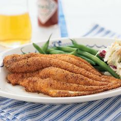 Cornmeal-Crusted Catfish: The bacon drippings used to cook the catfish lend this southern family favorite authentic flavor. Use the bacon in the coleslaw, or reserve for another use.