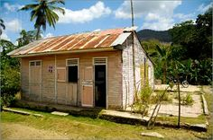 Dominican Republic wooden homes, look fragile yet throughout the years have been able to overcome so much in life.  Lovely, a steady job, a little paint, a new zinc plate with daily food on the plate would do quite fine.