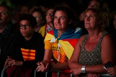 People wait for the results of the regional elections held in Catalonia on September 27, 2015 in Barcelona, Catalonia. The main Catalanist parties, Catalan Democratic Convergence 'Convergencia Democratica de Catalunya' party (CDC), Republican Leftist of Catalonia 'Esquerra Republicana de Catalunya' party (ERC) and a group of social associations have joined together to form a Catalan pro-independence coalition 'Junts pel Si' (Together for the Yes).