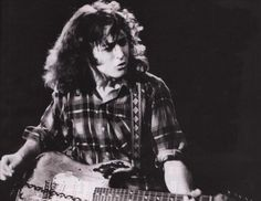 http://picture.fm/pictures/rory-gallagher/rory-gallagher_60mEBDgUho.jpg