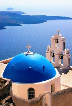 blue domed church with Aegean Sea, Fira, Santorini, Greece