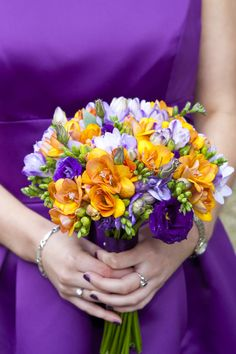 Freesia and Lisianthus bouquet for the Modern Bridal party.