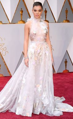 2017 Academy Awards: Hailee Steinfeld wears a super-romantic lavender gown with ruffle neckline and watercolor floral print with metallic details and Neil Lane jewelry.