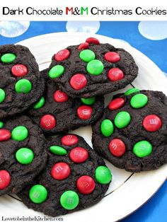 Beautiful dark chocolate cookies made with Hershey's Special Dark Cocoa Powder, packed full with chocolate chips and topped with colorful Dark Chocolate M&M's. These Dark Chocolate M&M Christmas Cookies are my new favorite cookie and perfect for Christmas! #cookies #christmas