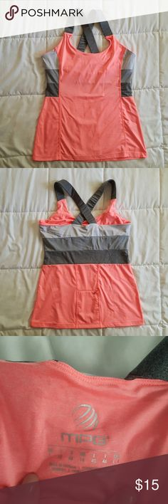 MPG Active tank. So cute! Re-poshing, ended up being to big.  Would fit a true size 12 really well,  and possibly a size 14 too.  Coral Color and three shades of grey.  Also called Mondeta Performance Gear.  Comes from a smoke free,  cat loving home. MPG  Tops Tank Tops