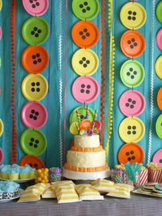 Paper plates with black paper circlrs (use paper punch) to decorate wall behind cake and rick rack.....WILL POST OUR GIRL'S PARTY PICS....stringing plates with clear fishing line and hanging throughout house as rain threatens venue.
