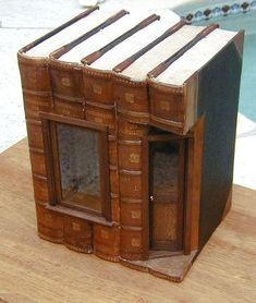 Old books into fairy house. I see so many discarded old books. What a great upcycle!