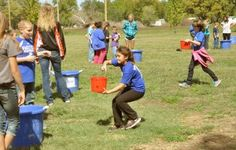 Fourth-graders experience effects of water - CCCHS FFAers showed fourth-graders how much water they use every day by having them carry it from a trough to tubs. The station stimulated what people had to do every day 100 years ago in carrying water from a well to their backyard.