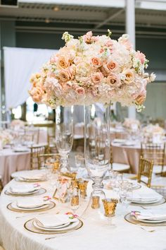 photo: Jasmine Lee; The blush color wedding centerpiece is so pretty; click to see more gorgeous details of this wedding.