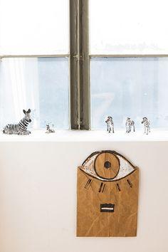 zebra figurines in sunny window in interior designer sally breer's frogtown loft. / sfgirlbybay