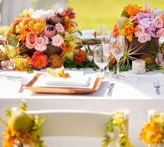 """Our take on """"tropical garden"""" for a reception table. Flower design by Passion Roots, Hawaii Wedding Florist. www.passionroots.com #tropical #wedding #garden #passionroots #hawaiiweddingflorist"""