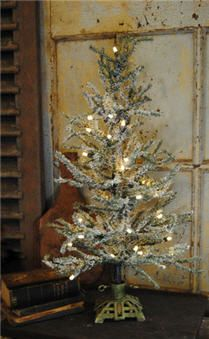 love the cast iron tree stand - A Country Christmas Cast