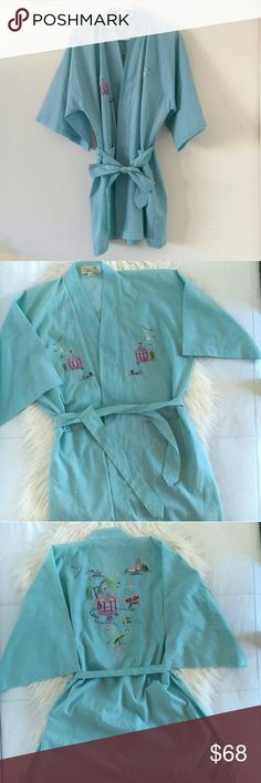 Vintage Embroidered Kimono Robe Beautiful pastel mint/blue colored vintage kimono/robe. Lightweight and thin fabric material, polyester and viscose blend. Has front pockets and belt included. Embroidery detail in front, with pagodas and nature scenes. Back embroidery is larger with pagodas, nature, cherry blossoms. Tag says medium but can fit small-large depending on fit preference. See measurements.   Bust measures 29' flat across.  Length is 35'.  Excellent condition. Open to offers.  No…