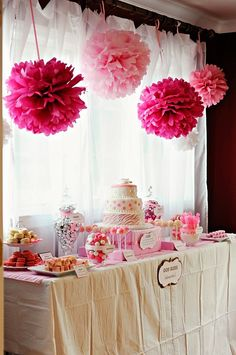 Girlie Birthday Party Decorations& Candy Bar - I absolutely love the Martha flower poms poms (would look great inside or outside in a tent) and the idea of a candy bar where little guests can fill their own goodie bag to take home at the end of the party.
