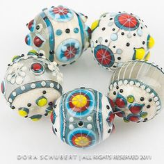"""Large round beads, lots of dots and stringer work #lampworkglassbeads #lampwork…"