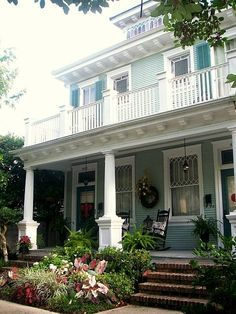 Beautiful landscaping and a great front porch! From No Minimalist Here.  #springintothedream homes-com-spring-into-the-dream