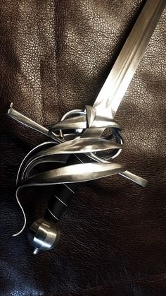 "Though not a proper Schiavona the hilt design is one of the ancestors of it. For this one it has been adapted for being use as a sideswordbacksword. Specs: Length: 110 cm - 43"" Width: 25 cm - 10"" ..."