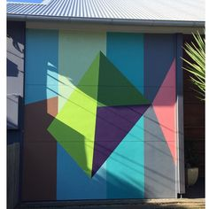 The garage door I painted several years ago. by louisetuckwell51