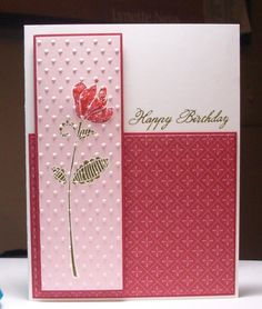 """By Lynette. Stamp flower on white cardstock strip; dry emboss in """"Swiss Dots"""" folder (Cuttlebug); layer on colored cardstock mat. Attach designer paper to lower part of white card base; pop up image panel at left. Add sentiment."""