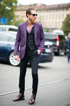 purple blazer, purple/white striped shirt, black vest, black trousers, dark brown leather shoes. So nice.