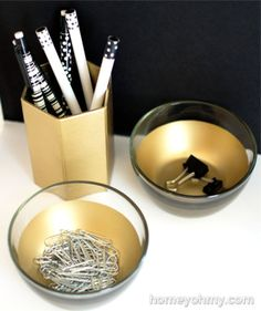 Your desk won't be overrun by stray paper and binder clips anymore when you have these gold-dipped bowls. You can purchase inexpensive glass bowls from IKEA, Bed Bath and Beyond, or your local home goods store for this project. Apply painter's tape to the rim of the bowl, tape aluminum foil to the outside of the bowls, and spray paint the inside of the bowls in a gold hue.