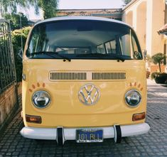 This is a yellow volkswagen van. It reminds me of a simpler time, or a time that is full of love and fighting injustice.