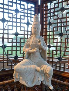 Kwan Yin Meaning | kwan yin the goddess of mercy and compassion sits on the moon in an ...