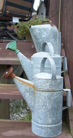 Less commonly found TALL NARROW WATERING CANS... WATERING CAN W/HOOD-LIKE AREA...